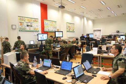 NATO coalition participants in CWIX 2012 man the Land Component Room at the Joint Forces Training Center in Bydgosczc, Poland. The facility will again host CWIX 2013 next month. (NATO Photo)