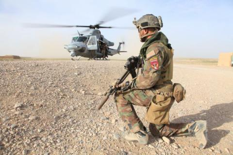 A Marine with U.S. Marine Corps Forces, Special Operations Command provides security at a landing zone in Nahr-e Saraj district, Helmand Province March 28.
