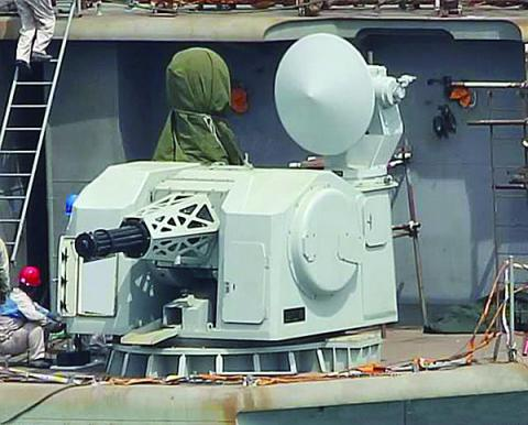 An indigenous design 11-barrel Gatling gun serves as a close-in weapon system aboard a Chinese aircraft carrier. The People's Liberation Army Navy has developed and adapted a variety of shipboard defense systems to suit different vessels. Photo: Hobby Shanghai (HSH)