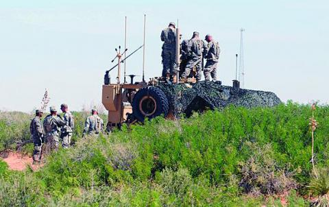 Soldiers in a Network Integration Evaluation set up communications in the New Mexico desert. The greater reliance on mobile communications, particularly the use of smartphones at the warfighter level, is requiring a new approach to information assurance.