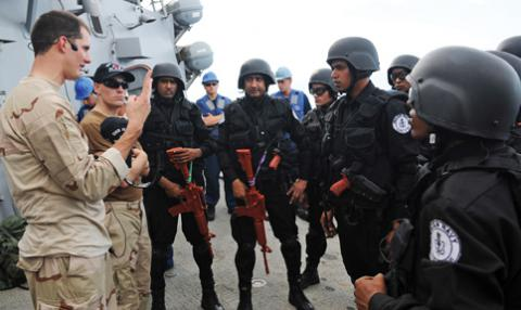 Ensign Timothy Eick, USN, gives a briefing to members of a visit, board, search and seizure team assigned to the Indian navy during a training exercise in 2012. Working with India remains a priority for U.S. Pacific Command after the 2014 elections resulted in a new ruling party in the peninsular nation.