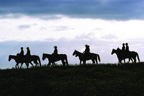 Border patrol personnel use horses to navigate remote terrain.