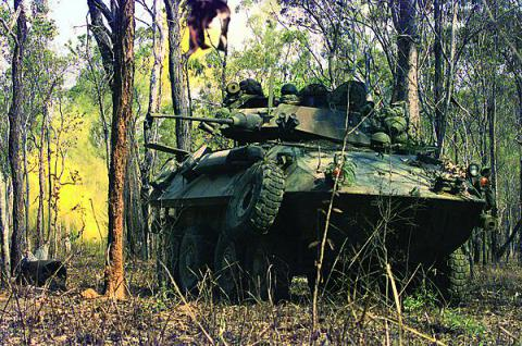 U.S. Marines from 3rd Light Armored Reconnaissance Company train the turret of their Light Armored Vehicle toward targets at the Shoalwater Bay Area Training Area in Queensland, Australia. Australia is one country in the Asia Pacific region expected to join the Coalition Interoperability Assurance and Validation working group.