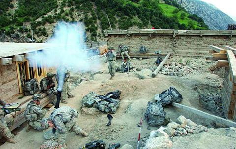 U.S. Army soldiers from the 10th Mountain Division's 3rd Brigade Combat Team fire mortars at the fighting positions of opposing forces during a combat operation in the village of Barge Matal in the eastern Nuristan province of Afghanistan in 2009. New technologies will give the unit unprecedented combat communications capabilities for its next deployment to Afghanistan, Army officials say.