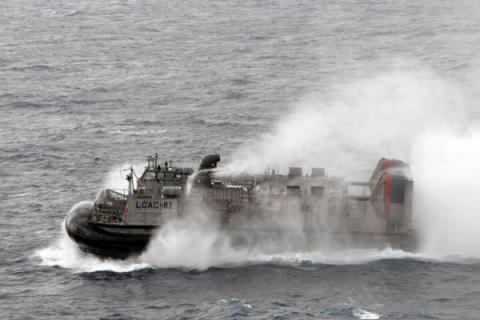 U.S. Navy Landing Craft, Air Cushion 81 departs the amphibious dock landing ship USS Tortuga (LSD 46) during an joint exercise with Japan. Budget chaos could threaten plans to shift forces to the Asia Pacific region while maintaining a presence in the Middle East.