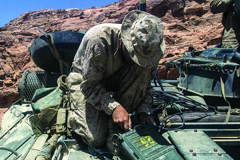 Lance Cpl. Tanner Ornduff, USMC, radio operator, sets up a AN/PRC-117F radio on an amphibious assault vehicle during a training event in Al Quweira, Jordan last year. The MCTSSA radio frequency laboratory began evaluating software-defined radios before they were widely deployed.