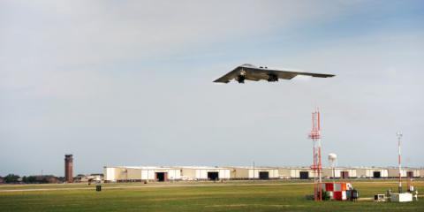 A B-2 Spirit from the 509th Bomb Wing lifts off of the runway at Whiteman Air Force Base, Mo., July 25, 2013. The alert klaxon, or loud speaker, at the base is part of a system developed by the Global Aircrew Strategic Network Terminal (Global ASNT) program office at Hanscom Air Force Base, Mass.