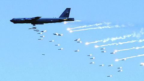A B-52 Stratofortress from Barksdale Air Force Base, Louisiana, drops live ordnance over the Nevada Test and Training Range during an Air Force firepower demonstration. An array of aircraft, including B-52s, unmanned vehicles, tankers and command and control aircraft, are destined to receive cutting-edge cryptographic systems designed by the U.S. Naval Research Laboratory.