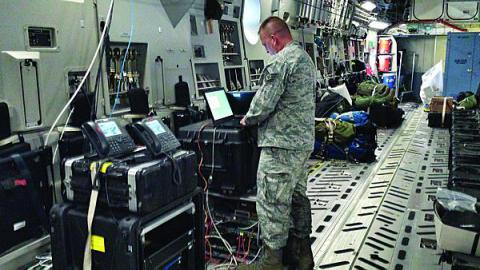 A member of the Joint Communications Support Element's (JCSE's) 4th Joint Communications Squadron ensures the JACC/CP en route communications package is online and functioning correctly. Four members of JCSE's 4th JCS provided en route communications to the U.S. Army's 4th Infantry Brigade Combat Team (Airborne), 25th Infantry Division during a 14-hour flight from Joint Base Elmendorf-Richardson, Alaska to Australia during Talisman Saber 13.