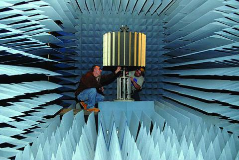 Two Tobyhanna Army Depot electronics experts set up a lightweight counter mortar radar system for rotation testing in an anechoic test chamber. This test removes the need for actual live-fire exercises and saves the Army tens of thousands of dollars for each system deployed to the field.