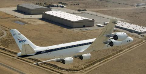 NASA's DC-8 airborne science laboratory flies over the Dryden Aircraft Operations Facility, Palmdale, California. The  DC-8 is participating in ACCESS flights measuring the emissions and performance of biofuels in jet engines.  (NASA Photo)