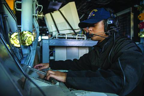A  U.S. Navy sailor monitors communications aboard an Arleigh Burke-class destroyer. The Defense Department's JIE builds on communications and networking advances within the individual services.