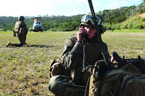 A radio operator for Combat Logistics Battalion-31, 31st Expeditionary Unit (MEU) communicates with the command element during a mass casualty evacuation exercise in Japan.