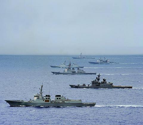 Ships from the Japan Maritime Self-Defense Force, the Republic of Korea Navy, and the U.S. Navy maneuver through the Pacific Ocean during a trilateral exercise. PACOM's J-6 directorate is working to enhance coalition communications in its area of responsibility.