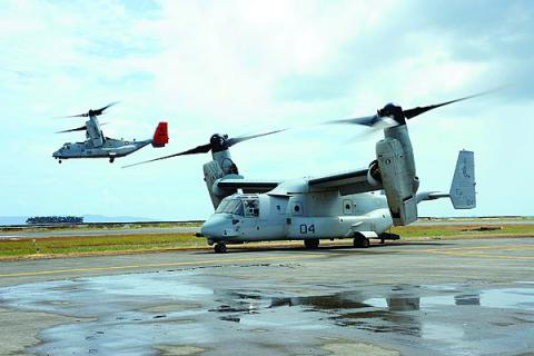 A U.S. Marine Corps MV-22 Osprey prepares for takeoff as another lifts off during Operation Damayan in Tacloban, Philippines. The cell phone infrastructure in Tacloban, the worst-hit area in the Philippines, still functioned after the storm. This allowed connectivity among military and nongovernmental organizations for coordinating relief efforts in that region.