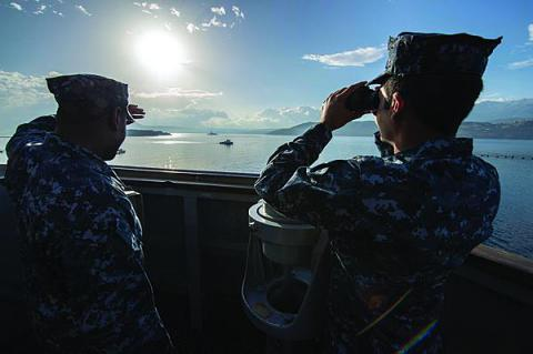 U.S. sailors on the bridge of the USS Ramage monitor a Spanish frigate as it departs Souda Bay during their scheduled deployment supporting maritime security operations and theater security cooperation efforts in the U.S. 6th Fleet area of responsibility.