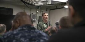 Vice Adm. Andrew Lewis, USN, commander, U.S. Second Fleet (c), speaks to USS Gerald R. Ford's (CVN 78) wardroom during a visit to the Navy's newest aircraft carrier. Adm. Lewis spoke at MILCOM 2019. U.S. Navy photo by Mass Communication Specialist 3rd Class Sean Elliott
