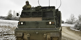 A U.S. Army M270 Multiple Launch Rocket System sits during a demonstration at the Grafenwoehr Training Area in Germany in February. The Army Futures Command is creating a software factory to train warfighters to code on the spot. Credit: U.S. Army photo by Spc. Denice Lopez