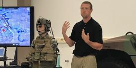 Lead Engineer Dan Lenhardt of the Communications-Electronics Research, Development and Engineering Center (CERDEC) explains the new speech recognition platform that the center developed to facilitate hands-free computer interaction for soldiers on the move.