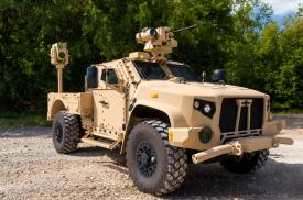 Boeing's compact laser weapon system, mounted on Oshkosh Defense's Joint Light Tactical Vehicle (JLTV), could provide counter-unmanned aerial vehicle protection for expeditionary warfighters, the company asserts. Credit: Oshkosh