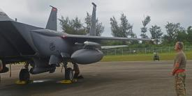 An airman from deployed from Mountain Home Air Force Base, Idaho, examines an F-15E Strike Eagle during preflight inspections at Tinian International Airport, Tinian during Pacific Iron 21 in August. To conduct such agile, more lethal movement of forces and airpower in the region, more software solutions are needed. Credit: U.S. Air Force photo by Tech. Sgt. Benjamin Sutton