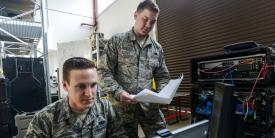 Senior Airman Thomas Goodnoe, USAF, tactical network operations technician, 1st Combat Communications Squadron (l), and Staff Sgt. Darryl Terry, USAF, cyber transport supervisor, 1st CBCS, review their systems against their technical guides during a cybersecurity audit in 2017 at Ramstein Air Base, Germany. The Air Force has added a new detachment that will provide initial training to cybersecurity airmen before they reach their mission locations. Credit: U.S. Air Force photo/Staff Sgt. Timothy Moore