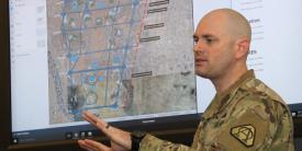 U.S. Army Project Manager Mission Command's (PM MC's) Maj. Tim Forry explains new software features of the Command Post Computing Environment recently at Aberdeen Proving Ground.