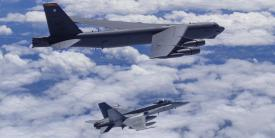A Canadian Forces CF-18 fighter intercepts a U.S. Strategic Command B-52 bomber over Canada as part of a coordinated exercise. Northrop Grumman is being awarded a $98 million contract to operate and maintain Strategic Command's command and control capabilities.