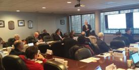 Douglas Maughan from the Department of Homeland Security speaks to AFCEA committee members.