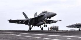 An F/A-18F Super Hornet aircraft lands on the flight deck of the aircraft carrier USS Theodore Roosevelt in the Persian Gulf, December 2, 2017. The Navy just tapped BAE Systems to produce integrated defensive electronic countermeasures for the F/A-18E-F aircraft platform. Navy photo by Petty Officer 3rd Class Rachael Treon.