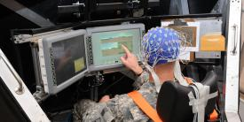 Scientists at the Army Research Laboratory (ARL) monitor a soldier's brainwaves as he operates systems in a simulated tank. The work seeks to understand thought patterns and physical states during combat pursuant to teaming the soldier with artificial intelligence.