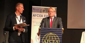 AFCEA Regional Vice President Harri Larsson (l) speaks with Swedish Defense Minister Peter Hultqvist at TechNet Europe 2017 in Stockholm.