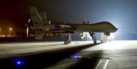 An MQ-9 Reaper sits on the flight line at Hurlburt Field, Florida, in 2014. The Reaper is an armed, multi-mission, medium-altitude, long-endurance remotely piloted aircraft primarily used as an intelligence-collection asset.