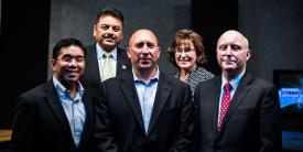 Tom Miller (c), CEO of ClearForce, stands with the judges who declared his firm's technology the winner in the second AFCEA Small Business Innovation Showcase Competition. Flanking Tom are (l-r) Glenn Hernandez, CISO, OpEdge Solutions LLC; Manoj Bhatia, president, Network Runners Inc.; Maria Horton, CEO of EmeSec; and Bill Jones, senior vice president of DSA's Integrated Solutions Group. Photo credit: Elizabeth Moon