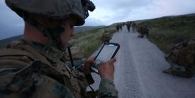 A U.S. Marine uses a tablet to communicate in real-time during the Infantry Officer's Course.