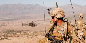 Capt. Jonathan Page, USA, uses the Rifleman Radio and Nett Warrior end user device of the Army's Network Capability Set 13 at Nangalam Base, Afghanistan. Harris Corporation and Thales Defense and Security Incorporated have been awarded contracts to produce the radio system.