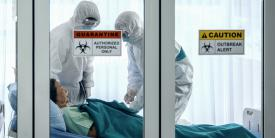 A COVID-19 patient is treated in a quarantine room by health care workers garbed in personal protective equipment. The pandemic has laid bare the shortcomings in U.S. national security emergency preparedness, and experts state that only a national effort will remedy the problem. Credit: Shutterstock/Mongkolchon Akesin