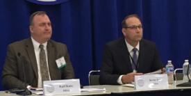 Karl Kurz, DISA Unified Capabilities Portfolio (l) and Kevin Tate of the DOD Office of the Chief Information Officer discuss the Defense Enterprise Office Solutions during a panel at TechNet Cyber.