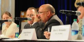 Gary Martin (c), program executive officer for command, control and communications-tactical (PEO C3T), discusses convergence at AFCEA's TechNet Augusta 2015 conference.
