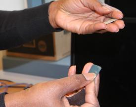 The Task ID and Access Management (TIDAM) program's tokens are lightweight, flexible and rugged. They can be inserted in a pocket, attached to a sleeve or integrated into a wristband.Credit: Douglas Scott