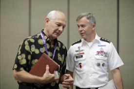 Lt. Gen. Bryan P. Fenton, USA, speaks with an attendee at TechNet Asia-Pacific.