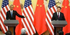 President Barack Obama and President Xi Jinping of China hold a press conference at the Great Hall of the People in Beijing, China, last year. Today, the two announced a historic agreement designed to curb cyber aggression.