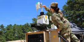 Staff Sgt. Keila Peters, USA, an embedded noncommissioned officer within the Army C5ISR Center, conducts testing on equipment for the command post survivability effort during Network Modernization Experiment 20 at Joint Base McGuire-Dix-Lakehurst, New Jersey, July 27, 2020. The Army's new deputy chief of staff for G6 has laid out three pillars for his restructured office that include cyber, signal, electronic warfare and networking priorities. Credit: U.S. Army C5ISR Center photo/Jasmyne Douglas