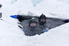 Navy divers participate in under-ice training at Camp Ripley, Minnesota, on February 8. A variety of factors, including melting Arctic ice caps, could require a greater focus on maritime operations. Photo by Navy Staff Sgt. Anthony Housey