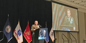 Lt. Gen. Robert F. Hedelund, USMC, commander, U.S. Marine Corps Forces Command, addresses the MILCOM 2019 audience.