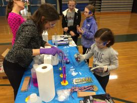 Graduates from Yale engage young students in chemistry experiments at last year's Make-Her Fair.