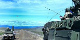 The Army tests an integrated mounted reconnaissance capability on a manned Stryker and an unmanned ground system called the Squad Maneuver Equipment Transport during the Joint Warfighter Assessment (JWA) 2019 in December. The Army is preparing Joint All-Domain Command and Control, or JADC2, capabilities to test at the next JWA in 2021. Credit: U.S. Army photo by Jack Bunja.