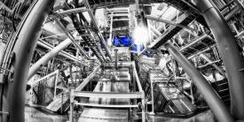 Beamlines entering the lower hemisphere of the National Ignition Facility's target chamber. Lawrence Livermore researchers have successfully combined nine of the facility's 192 laser beamlines into one directed pulse of light. (Photo: Damien Jemison/LLNL)
