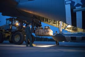 Airmen from the 37th Airlift Squadron and 86th Logistics Readiness Squadron load a low-cost low-altitude drop into a C-130J Super Hercules aircraft as the flight crew prepares for a night-time training mission during 2021 Aviation Detachment Rotation at 33rd Air Base near Powidz, Poland. The LCLA drop contents would consist of supplies or equipment for a small subset of units. Credit: U.S. Air Force photo by Senior Airman Kristof J. Rixmann