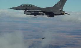Collaborative Small Diameter Bombs (CSDBs) are launched from the wing of an F-16 fighter. Four of the bombs were dropped during the second flight demonstration of the Air Force Golden Horde Vanguard.  Courtesy photo U.S. Air Force